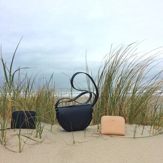 Three sustainable wonders at the beach   From left to right, wallet Toni in black, saddle bag Mavi in black and wallet Toni in natural                #sustainablebags #ZAMT #ZAMTberlin #sustainability #ecofriendly #sustainable #sustainableliving #sustainablefashion #slowfashion #consciousfashion #buylesswearmore #buylessbutbetter #qualityoverquantity #madeinberlin #patina #sustainablefashionbrand #baglovers #ecobags #handmade #vegtanned #bagdesign #productdesign #ethicalfashion #smallbusiness #smallbrand #minimalist #madewithlove #supportsmalllabels